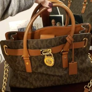 Authentic Michael Kors purse w/ matching wallet